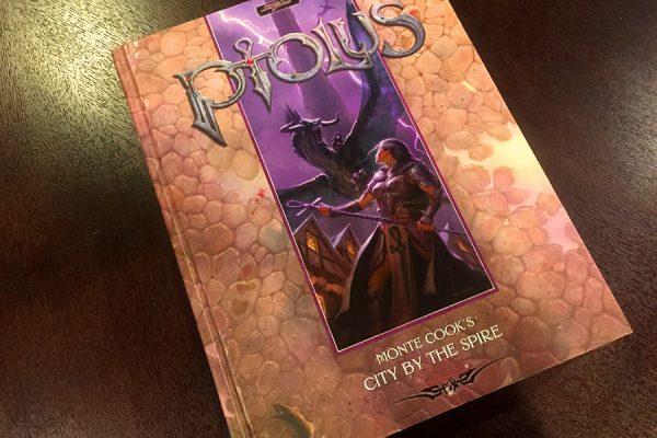 Ptolus book on table