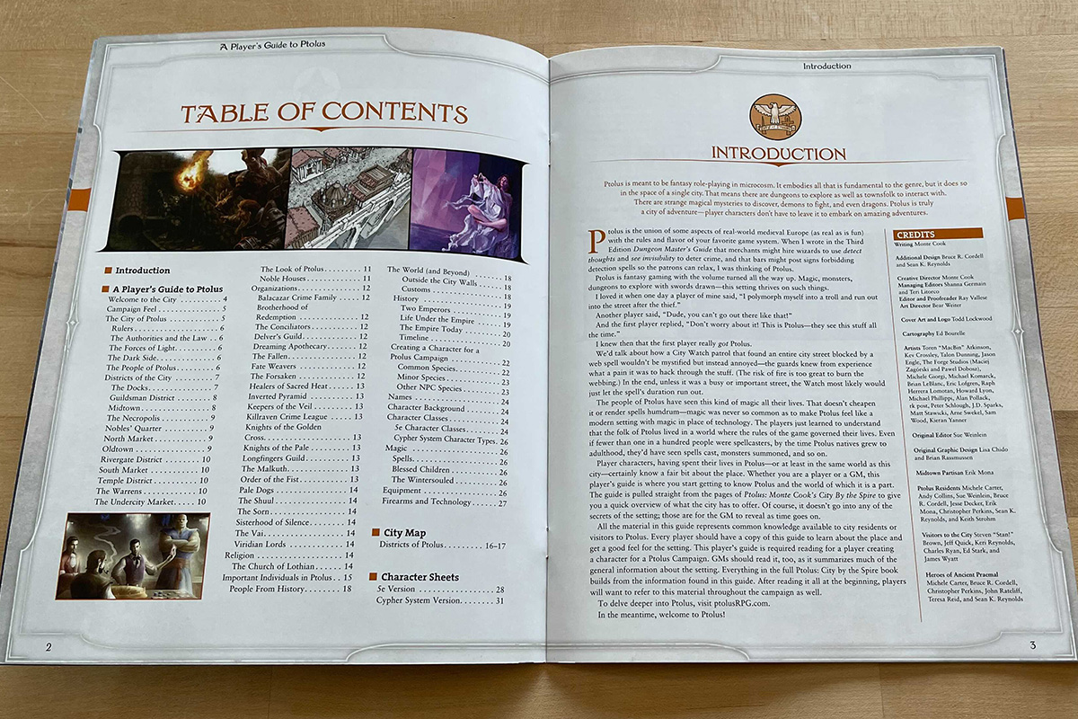 The image shows A Player's Guide to Ptolus open to the table of contents and introduction.